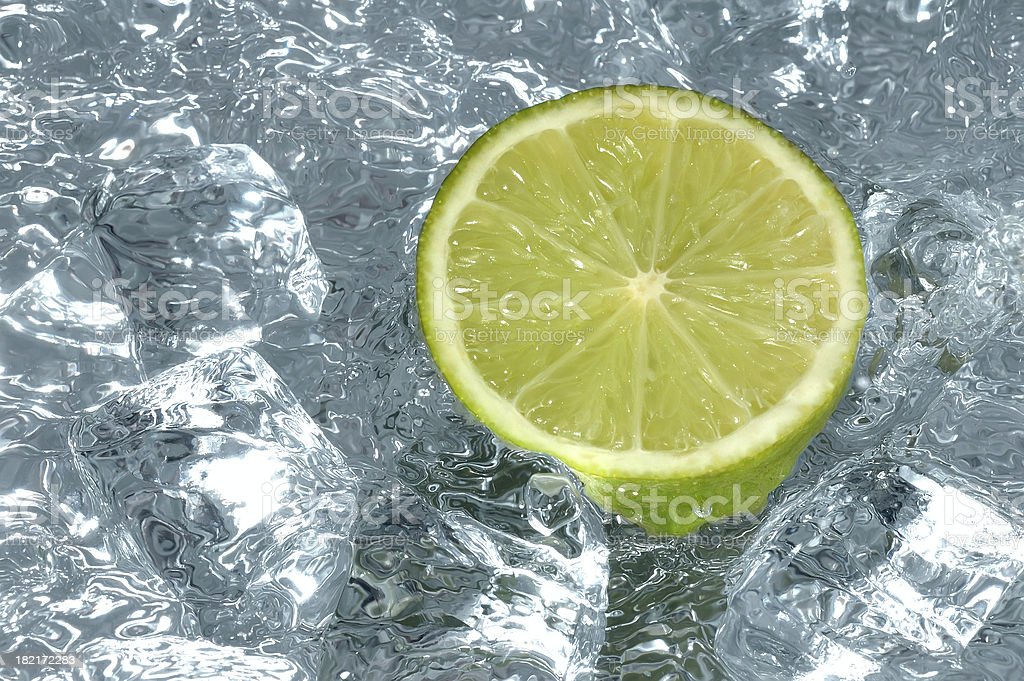 Lemon, water and cubes royalty-free stock photo