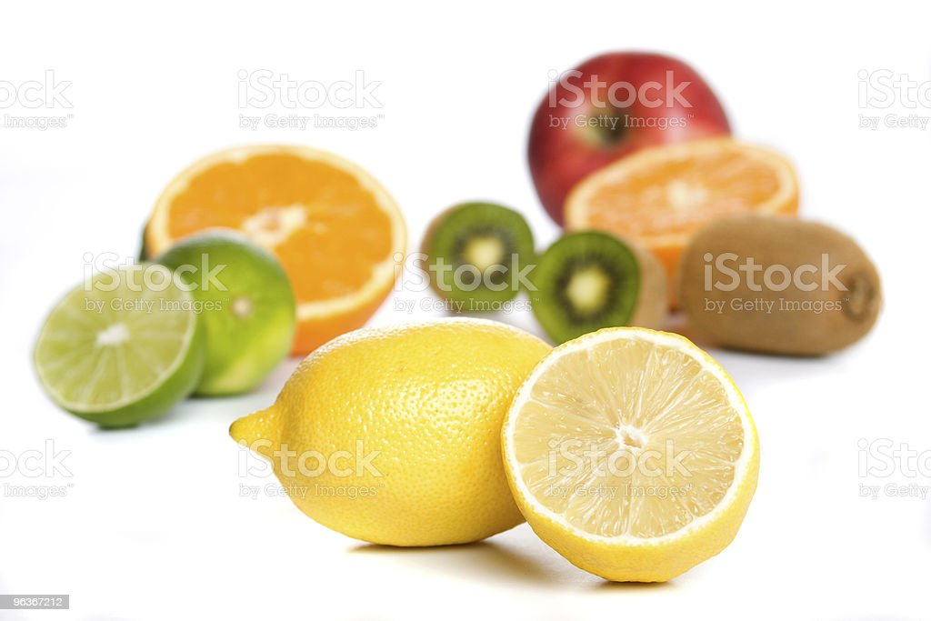 Lemon with other fruit isolated on white stock photo