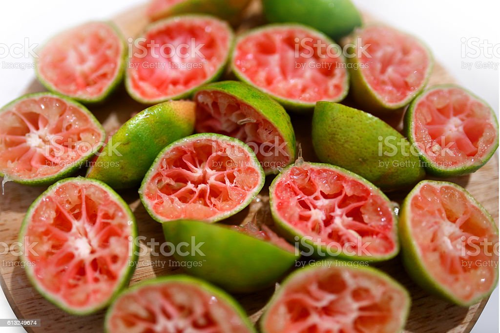 Lemon with rosy pulp (Citrus aurantifolia) stock photo