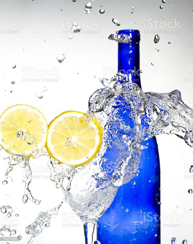 lemon with spray water.  Creativ splashing stock photo