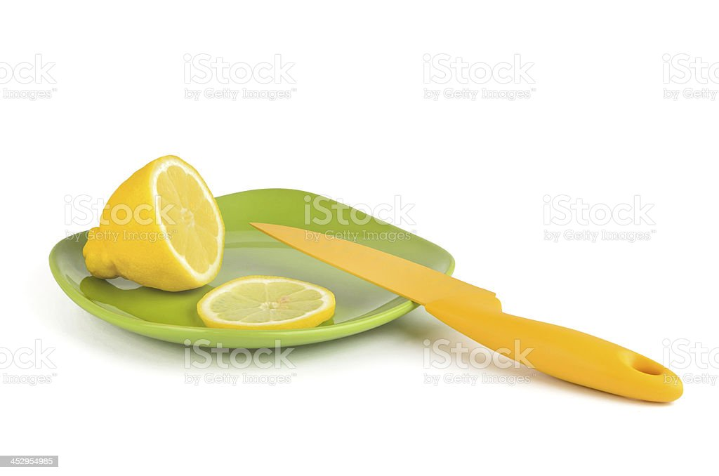 Lemon yellow and knife royalty-free stock photo