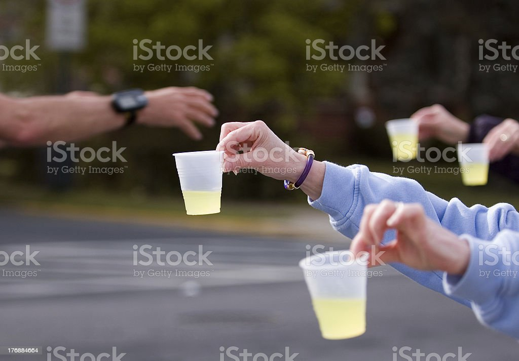 Lemonade Hand Off stock photo