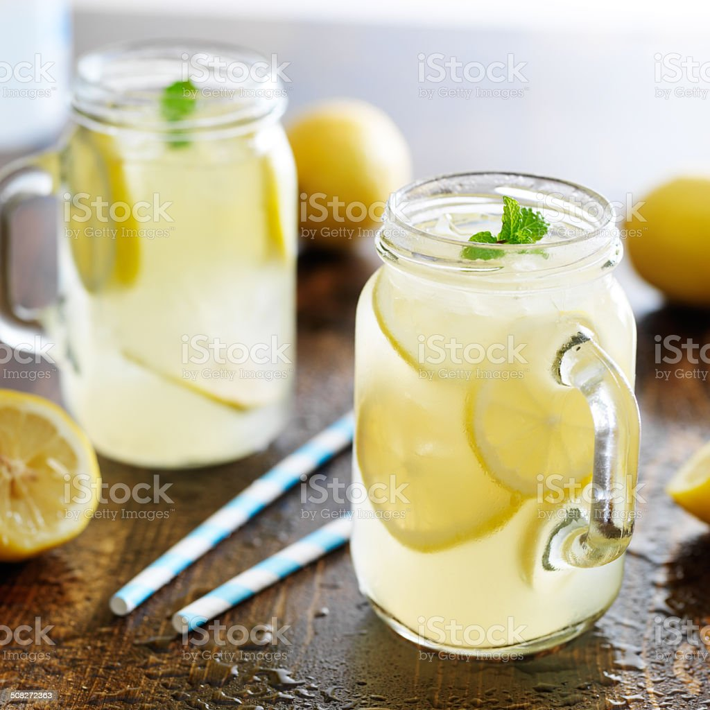 lemonade in jar with ice and mint stock photo
