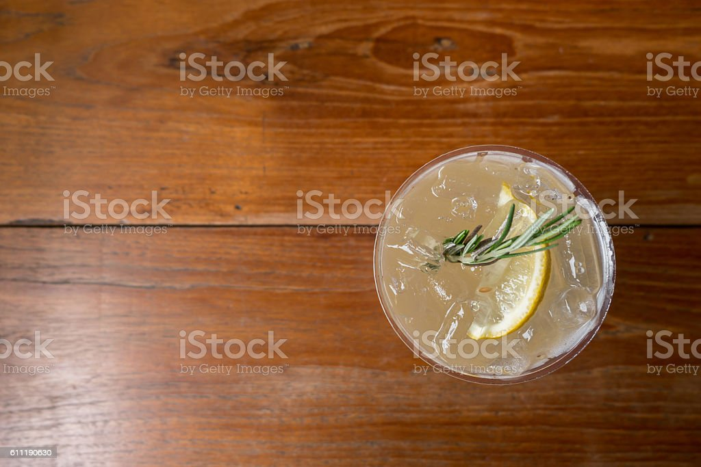 Lemonade in plastic cup on wooden table. Top view stock photo