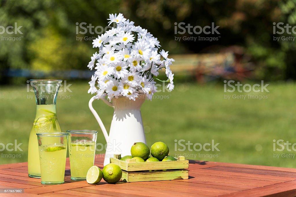 Lemonade, Limes with Daisy stock photo