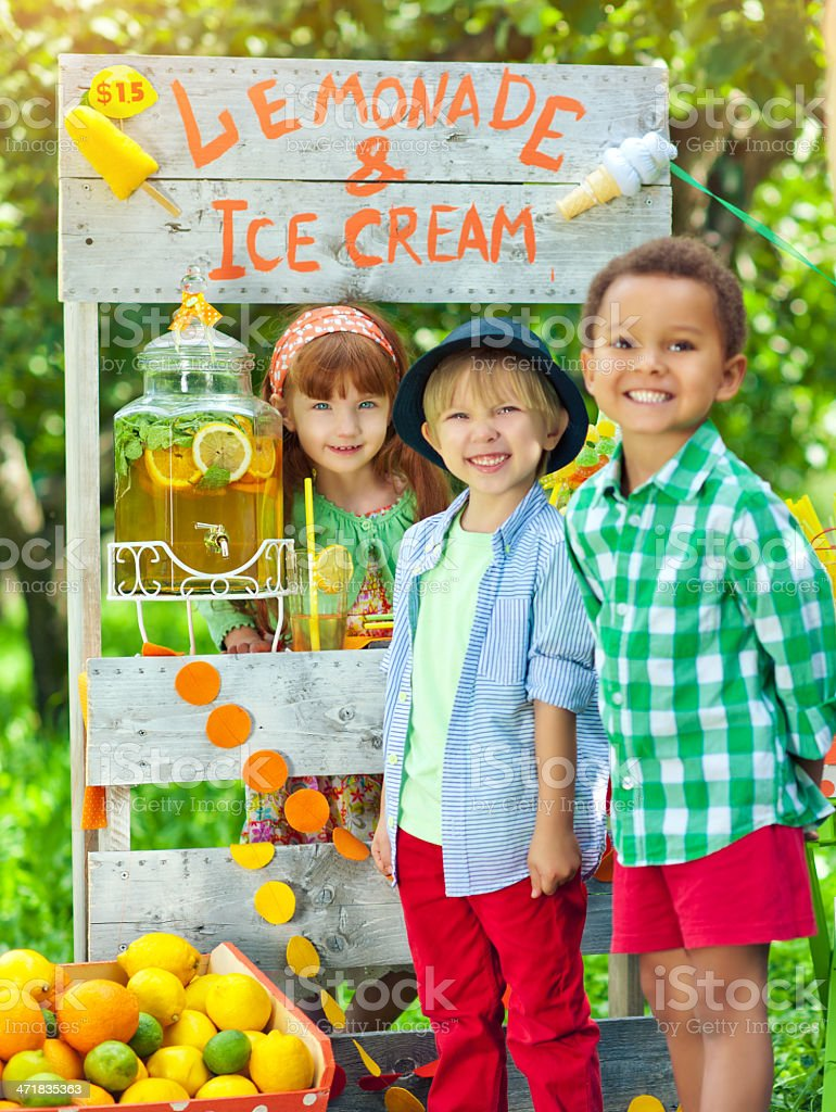 Lemonade stand and children royalty-free stock photo