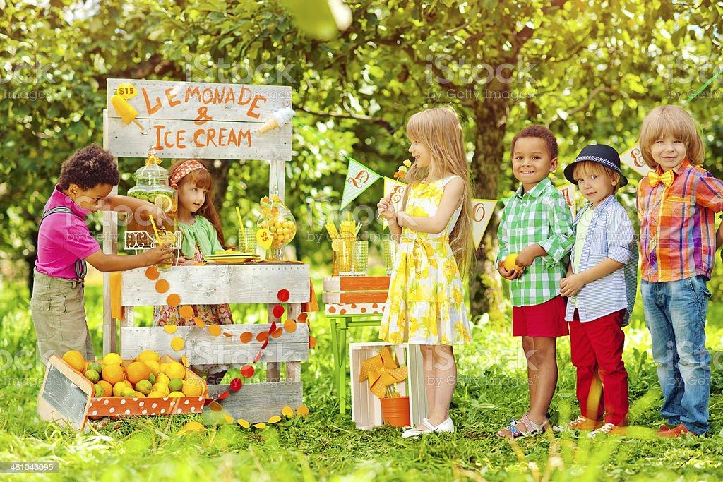Lemonade stand and children stock photo