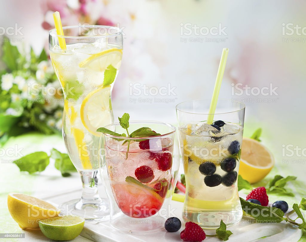 Lemonade with berries and fruits stock photo