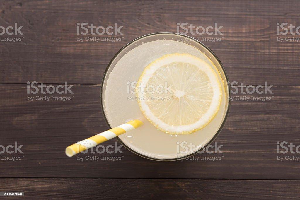 lemonade with fresh slice lemon on wooden background stock photo
