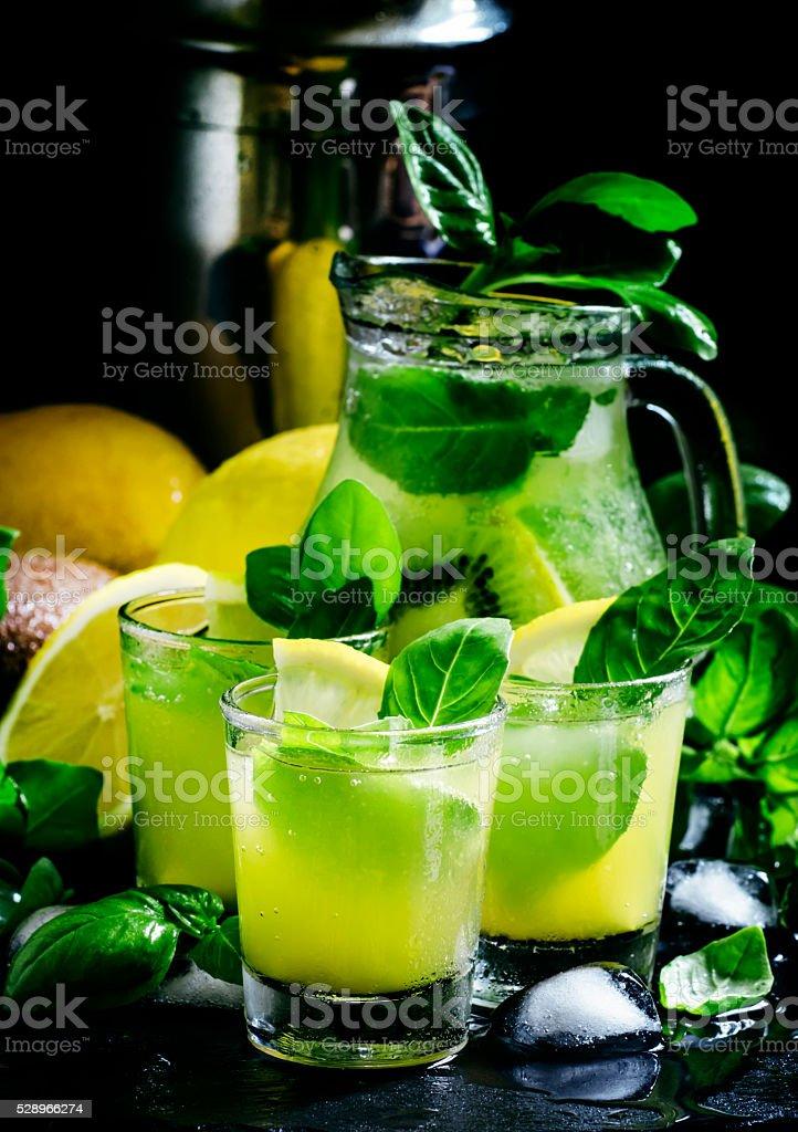 Lemonade with kiwi, green basil, grapefruit syrup and ice stock photo