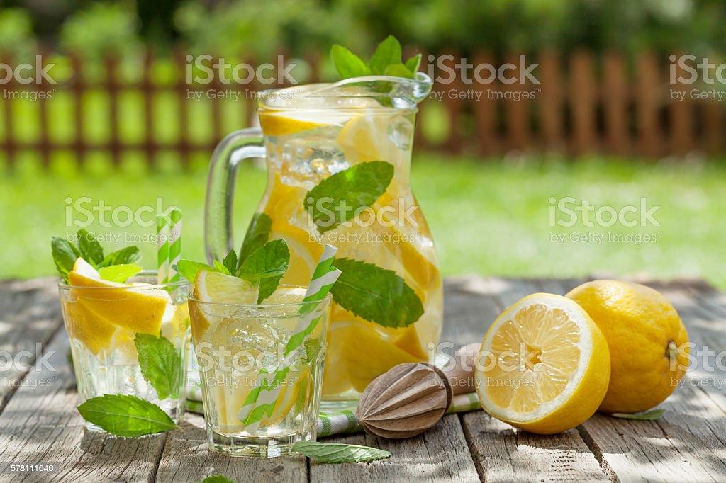 Lemonade with lemon, mint and ice stock photo