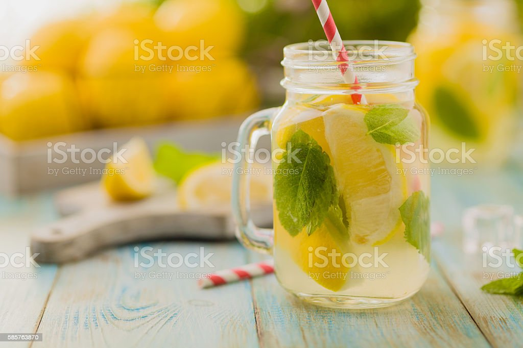 lemonade with mint on rocks served in jar stock photo