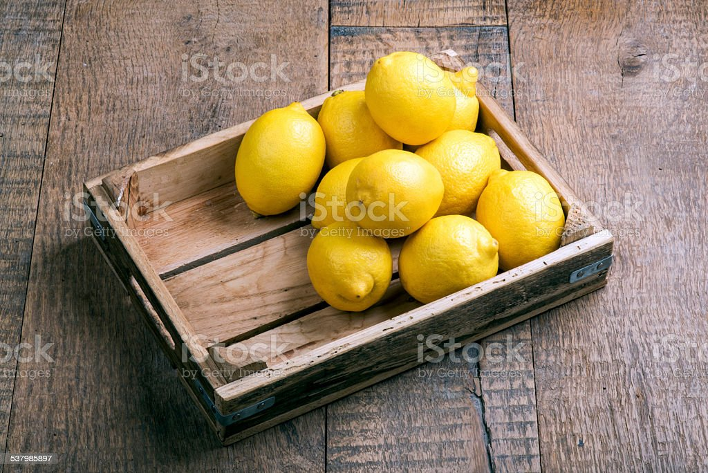 Lemons and Container stock photo