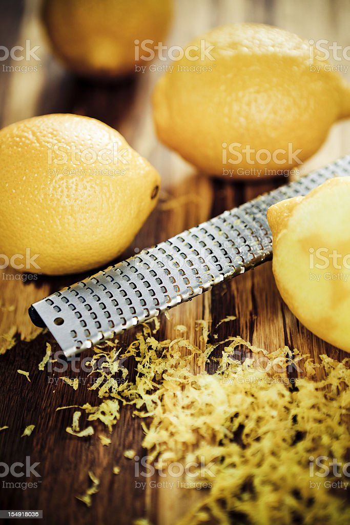 Lemons, grater and zest. stock photo