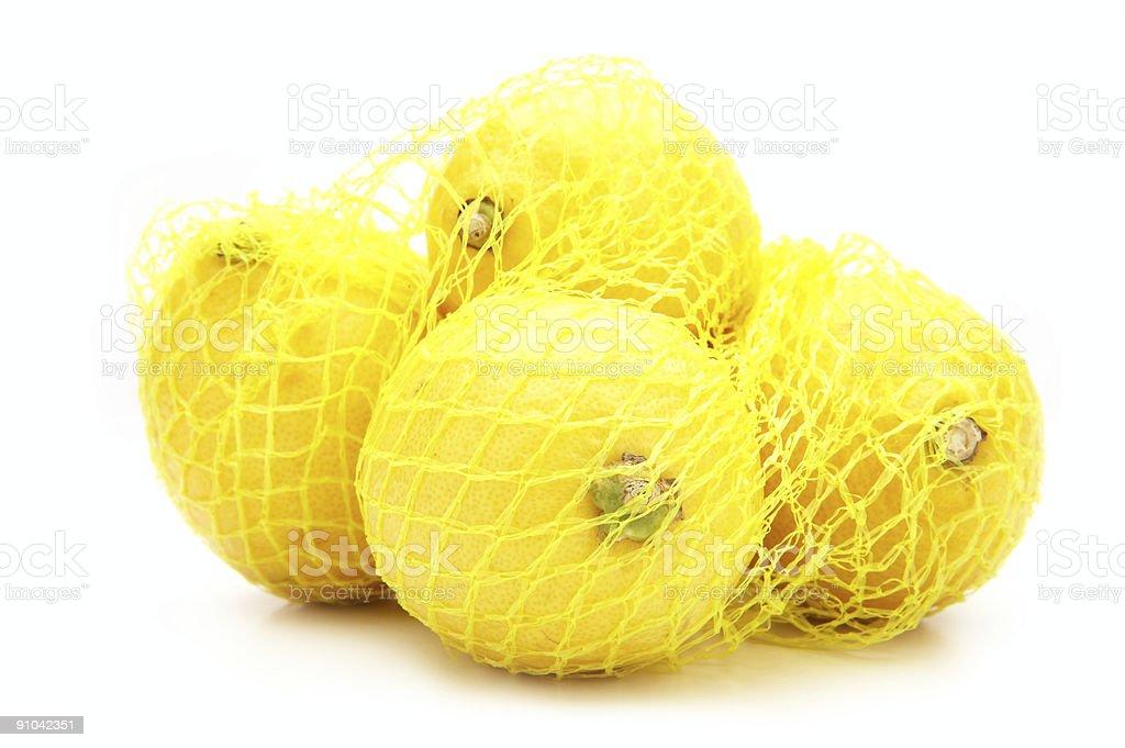 Lemons in the net royalty-free stock photo
