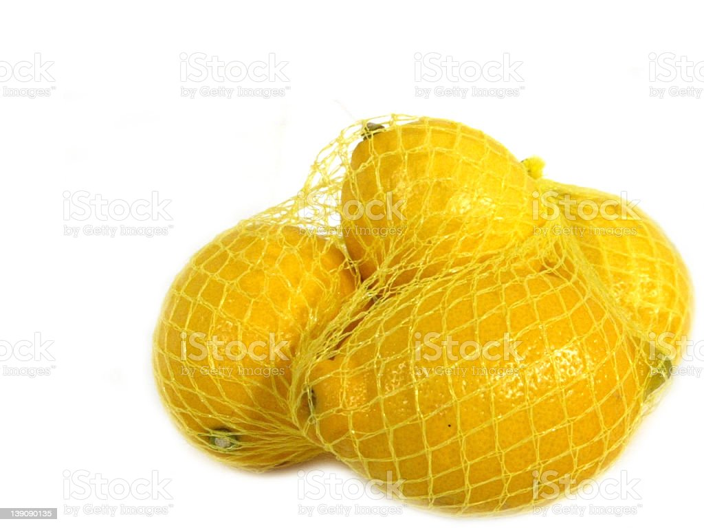 4 lemons in yellow net royalty-free stock photo