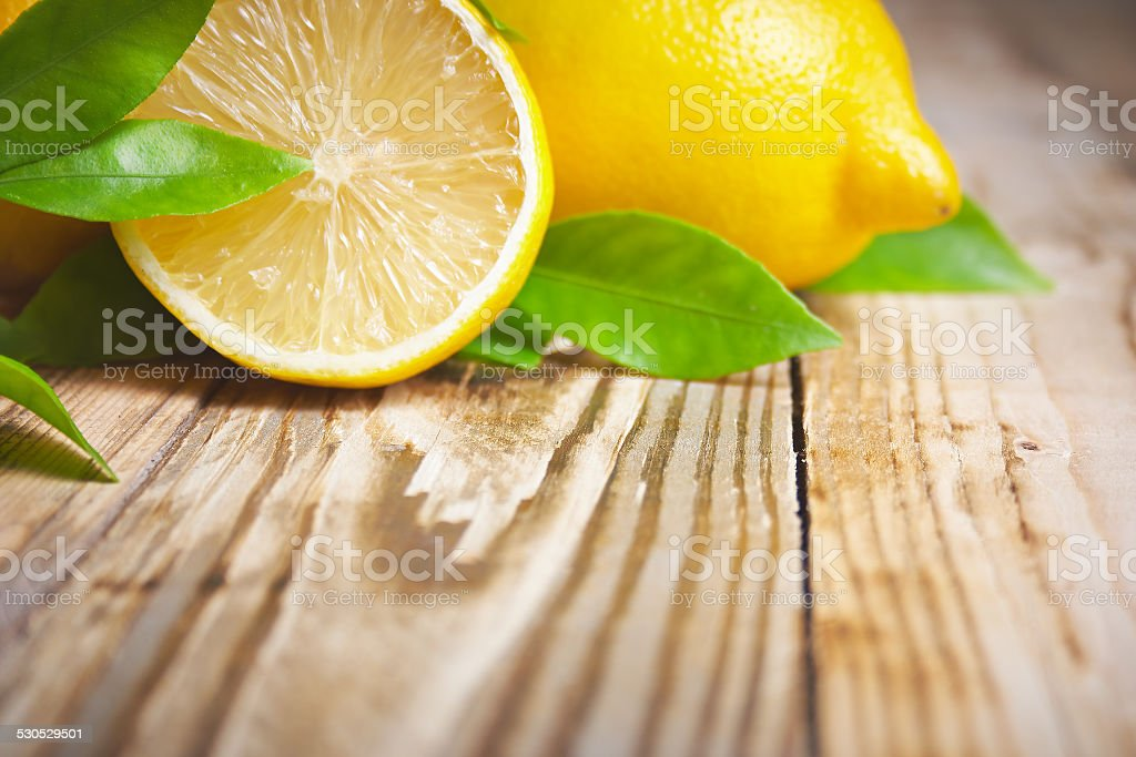 Lemons on a wooden background stock photo