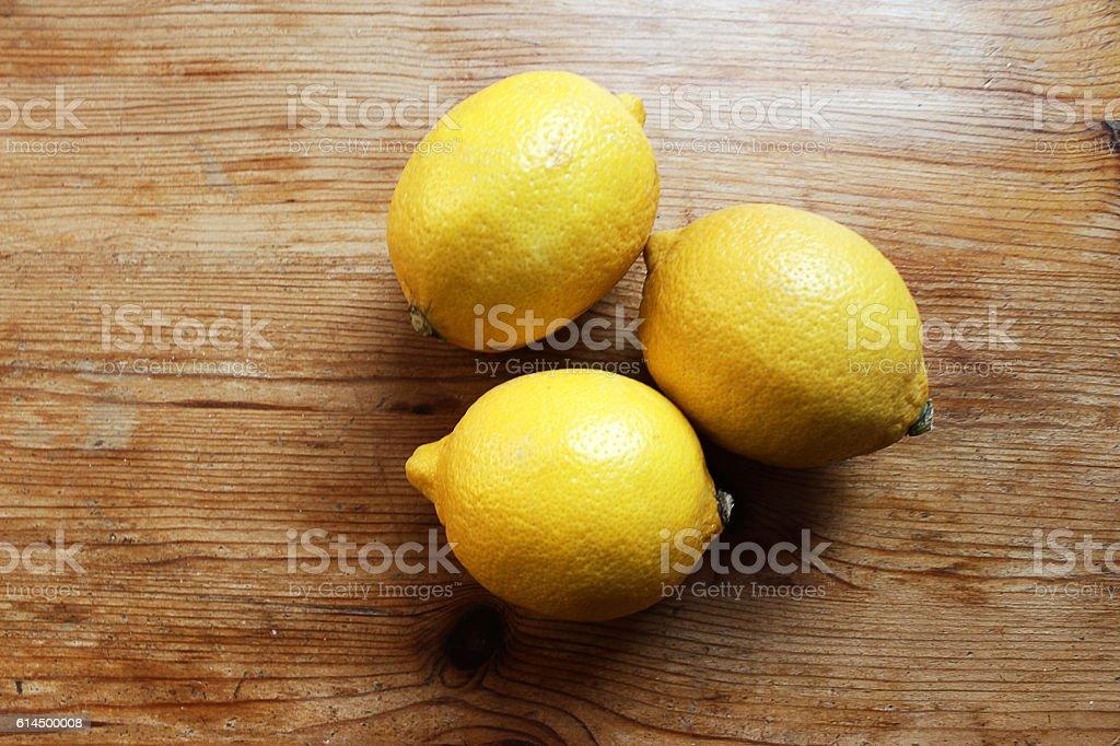 Lemons on a wooden desk stock photo