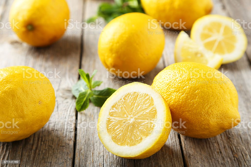 Lemons on grey wooden background stock photo