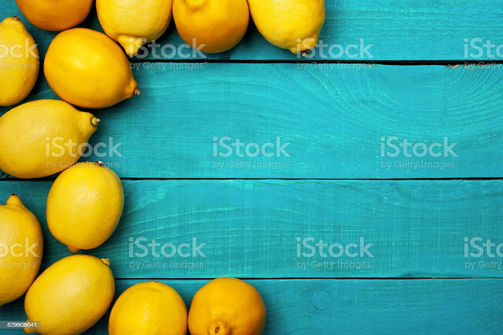 Lemons on the bright cyan background stock photo