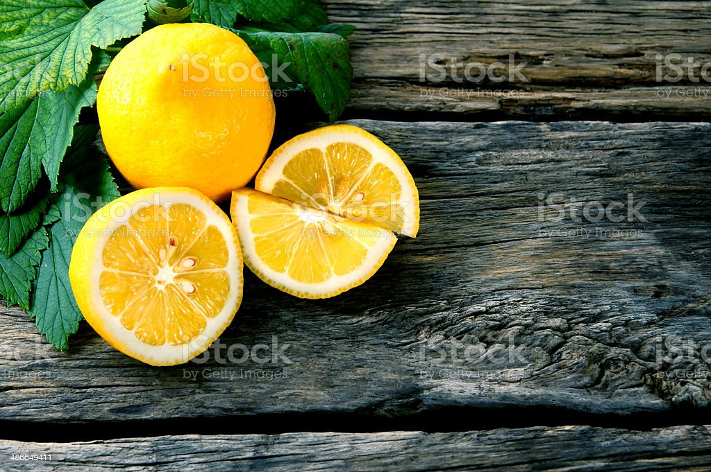 Lemons. On wooden board. stock photo