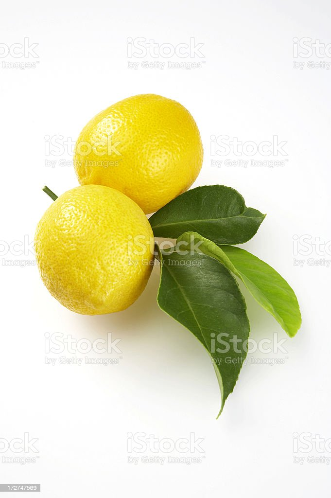Lemons with leaves on white background royalty-free stock photo
