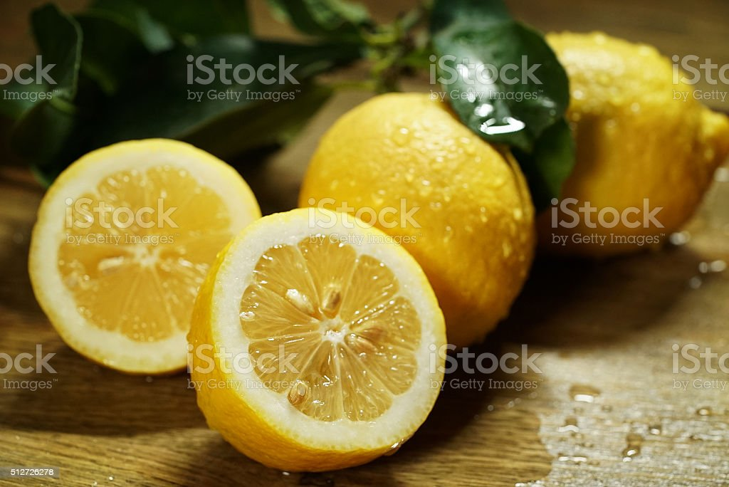 Lemons with leaves on wooden boards stock photo