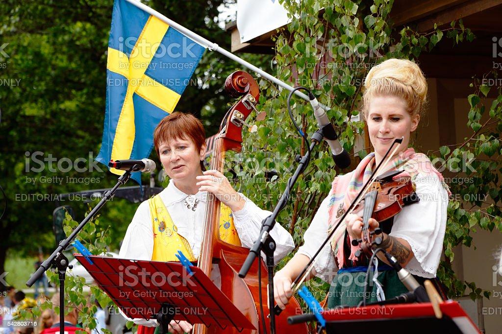 Lena and Agnes Odén plays folk music stock photo