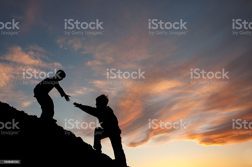 Lending A Helping Hand To a Brother In Need stock photo