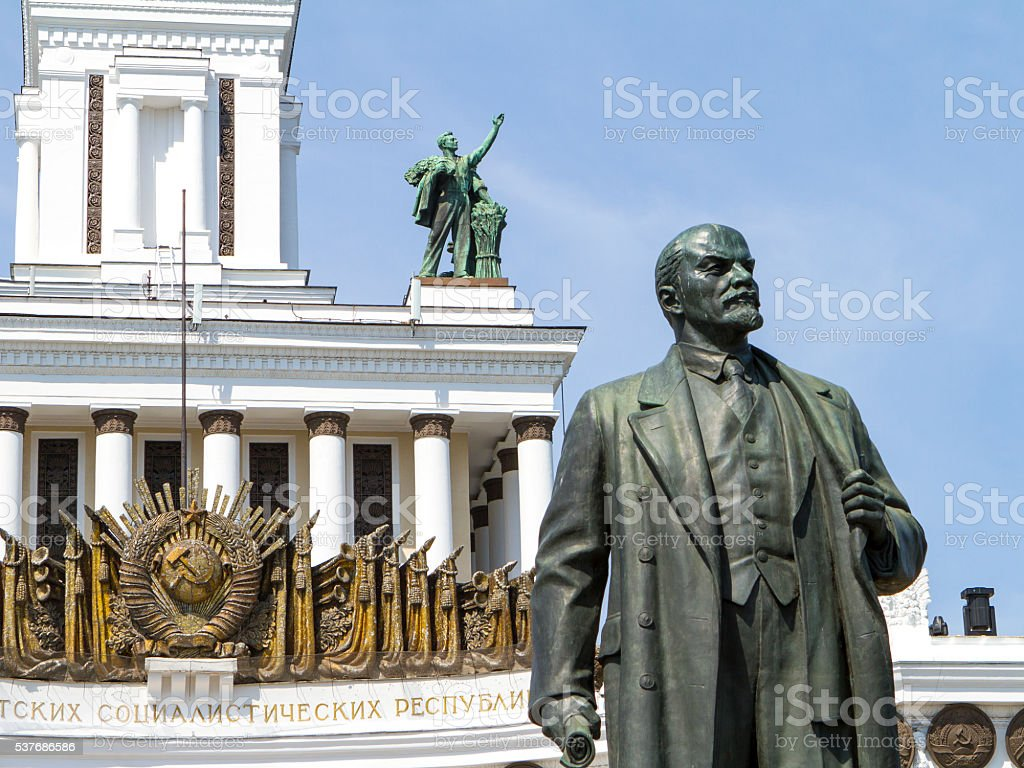 Lenin looks supicially at Stalin stock photo