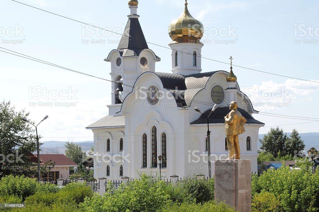Lenin staying up an Orthodox Church stock photo