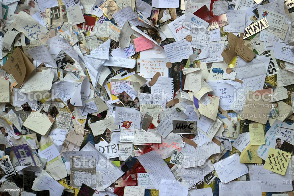 Lennon wall covered with notes stock photo