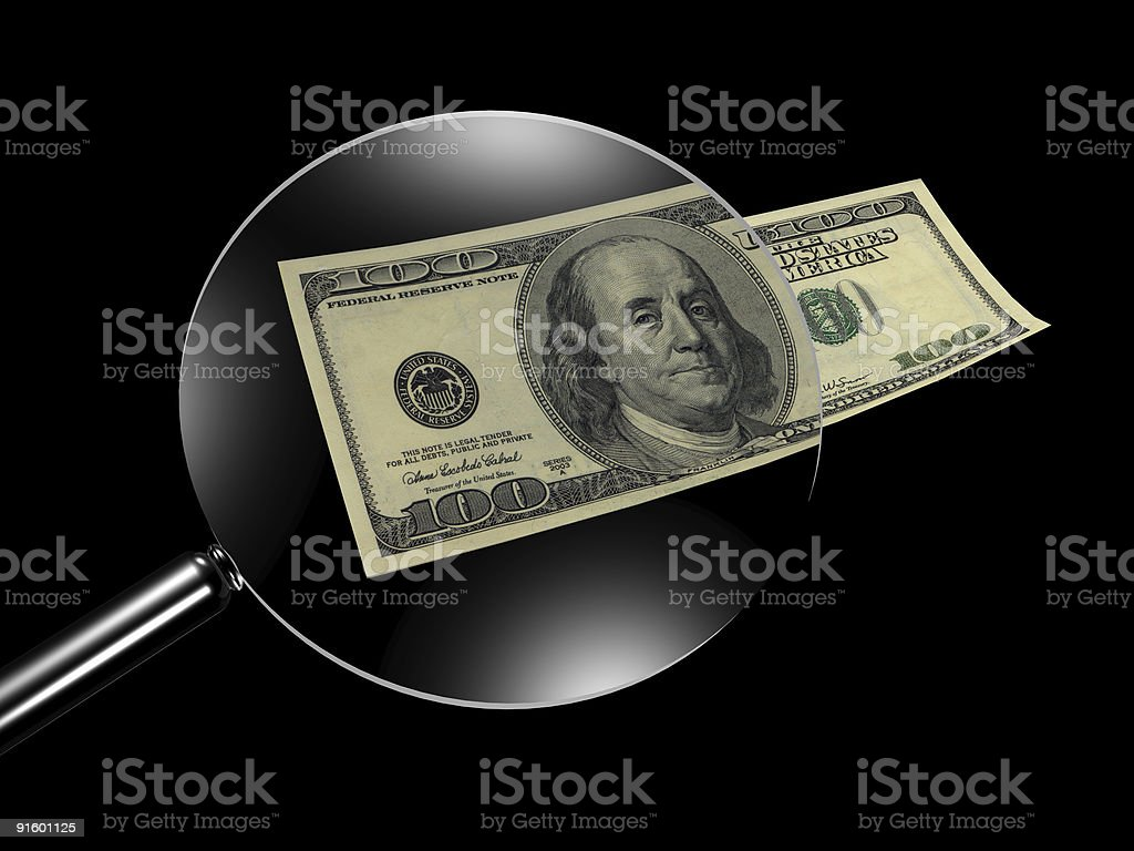 Lens and dollars royalty-free stock photo