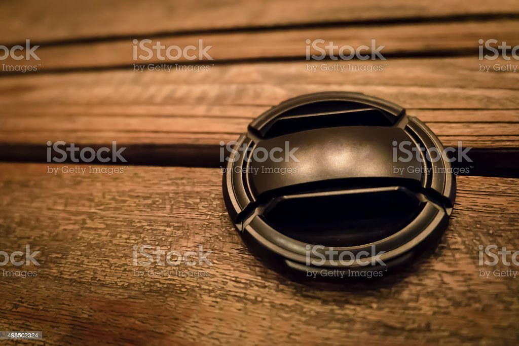 Lens cap on the wood stock photo