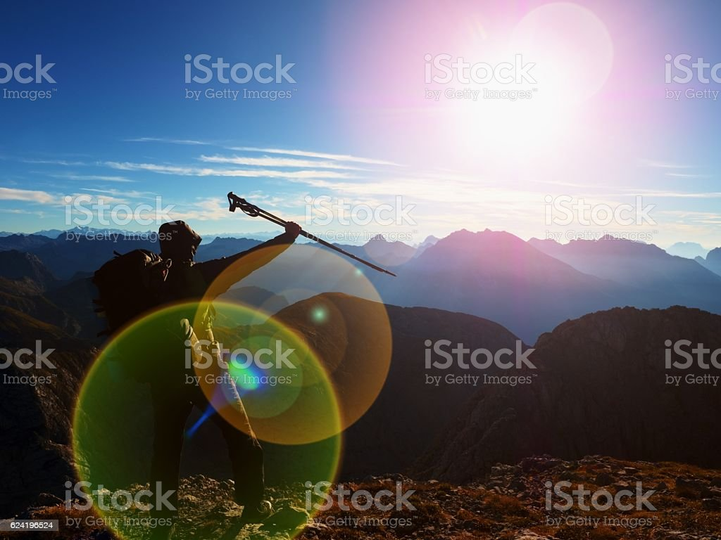 Lens flare defect. all backpacker with poles. Sunny weather stock photo