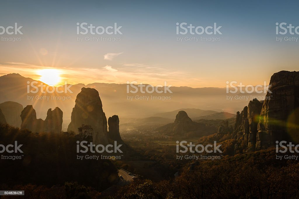 Lens flare from the sunset ower Meteora valley in Greece stock photo