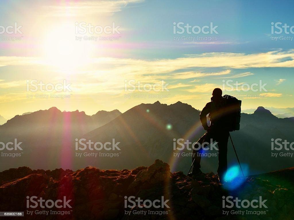 Lens flare. Hiker takes selfie photo. Tourist at peak stock photo