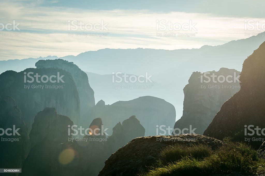 Lens flare on the beckground of layers of the rocks stock photo