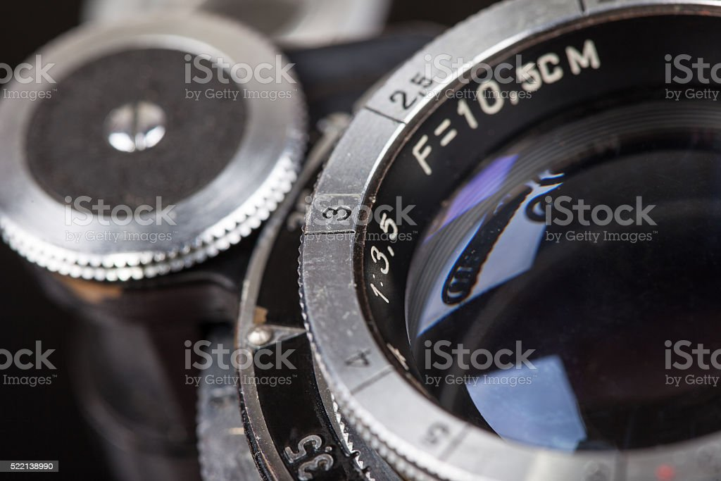 Lens of retro camera selective focus macro closeup stock photo