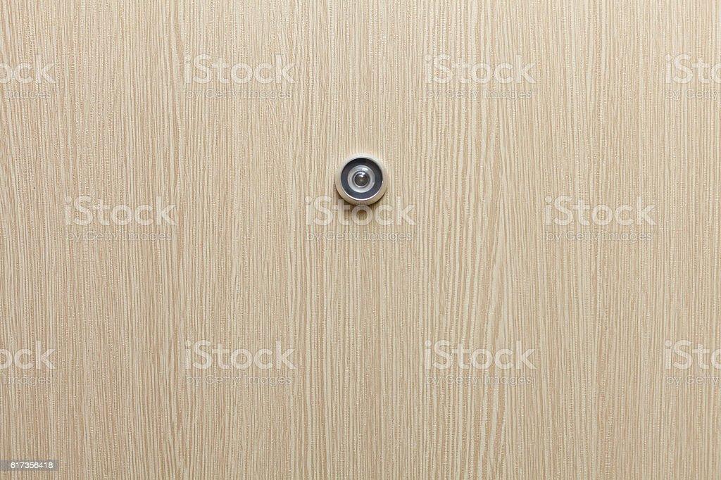 Lens peephole on new wooden door stock photo
