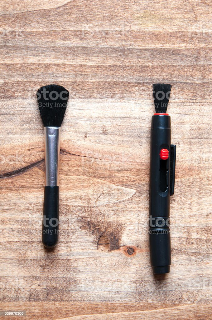 Lens pen and brush for cleaning camera stock photo