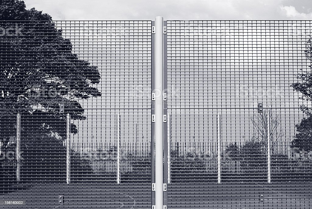 Lens sharpness test - wire mesh boundary stock photo