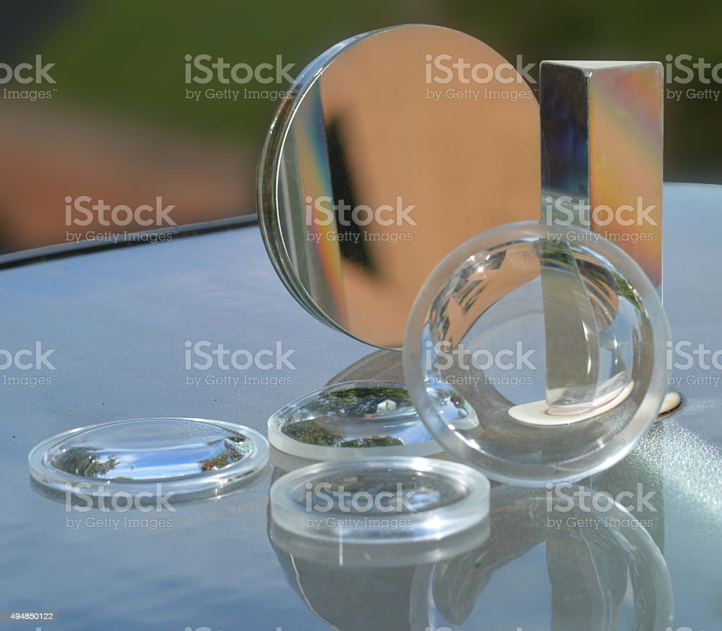 lenses, mirror, and prism stock photo