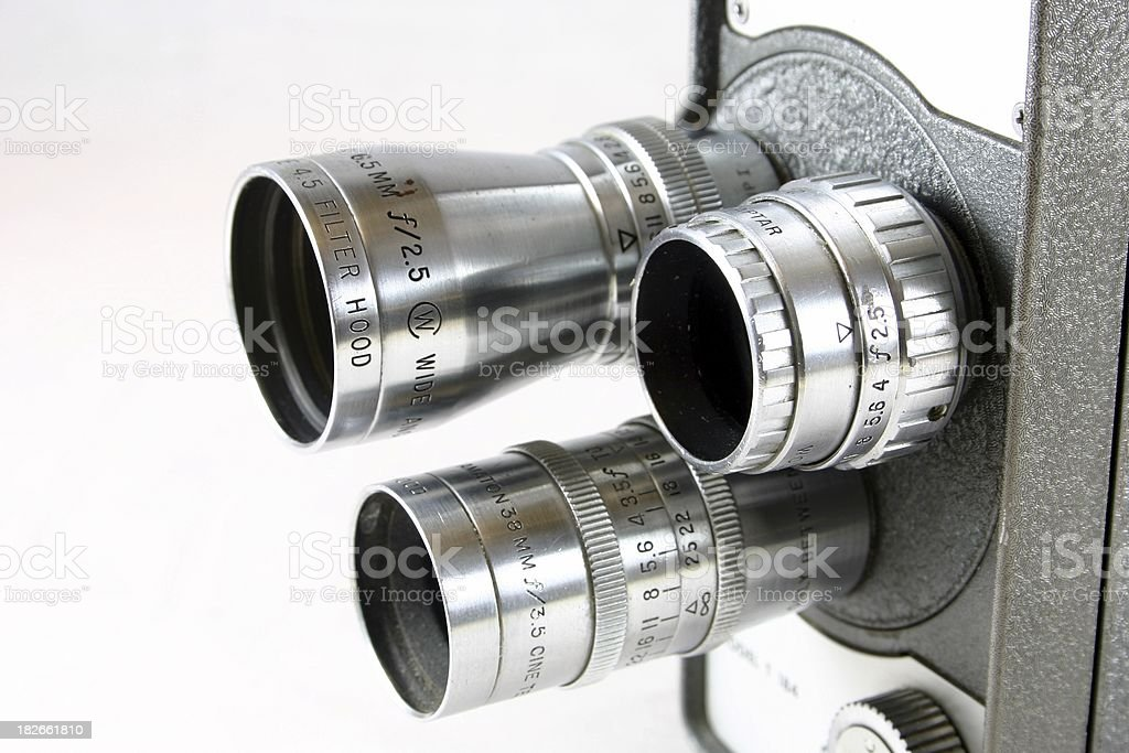 Lenses on old movie camera stock photo