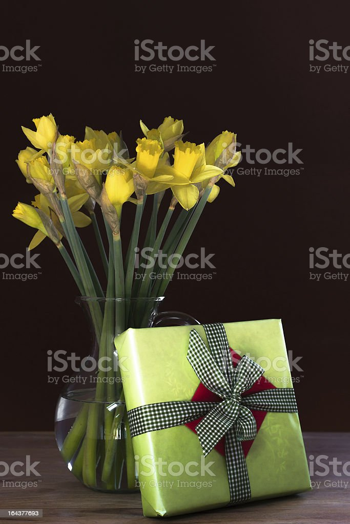 Lent lily daffodil in a glass vase with Easter gift royalty-free stock photo