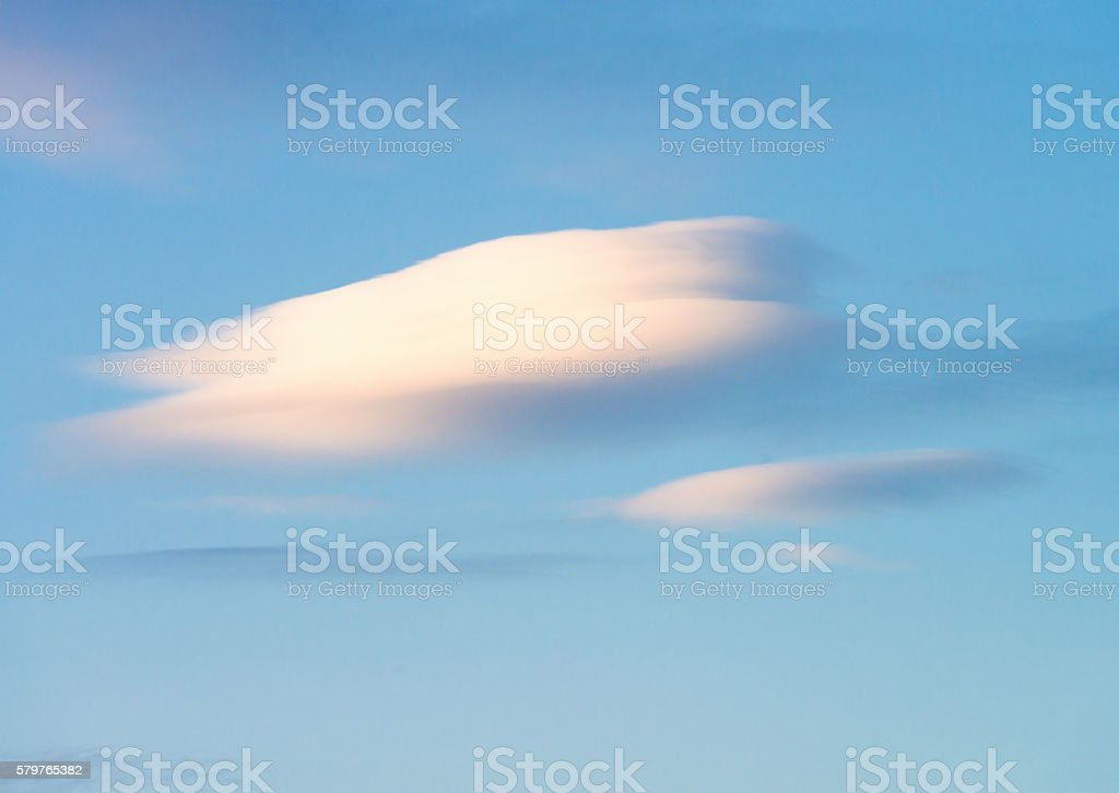 Lenticular cloud in summer sky stock photo