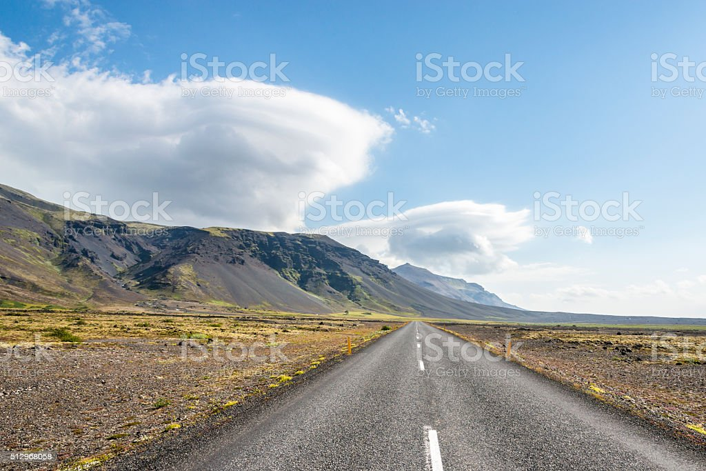 Lenticular clouds on the road to Reykjavik. Iceland. stock photo