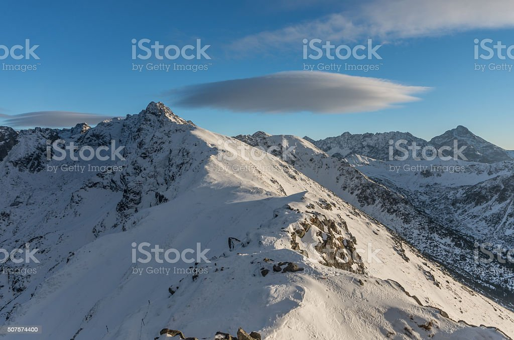Lenticular clouds over High Tatras at winter, afternoon stock photo