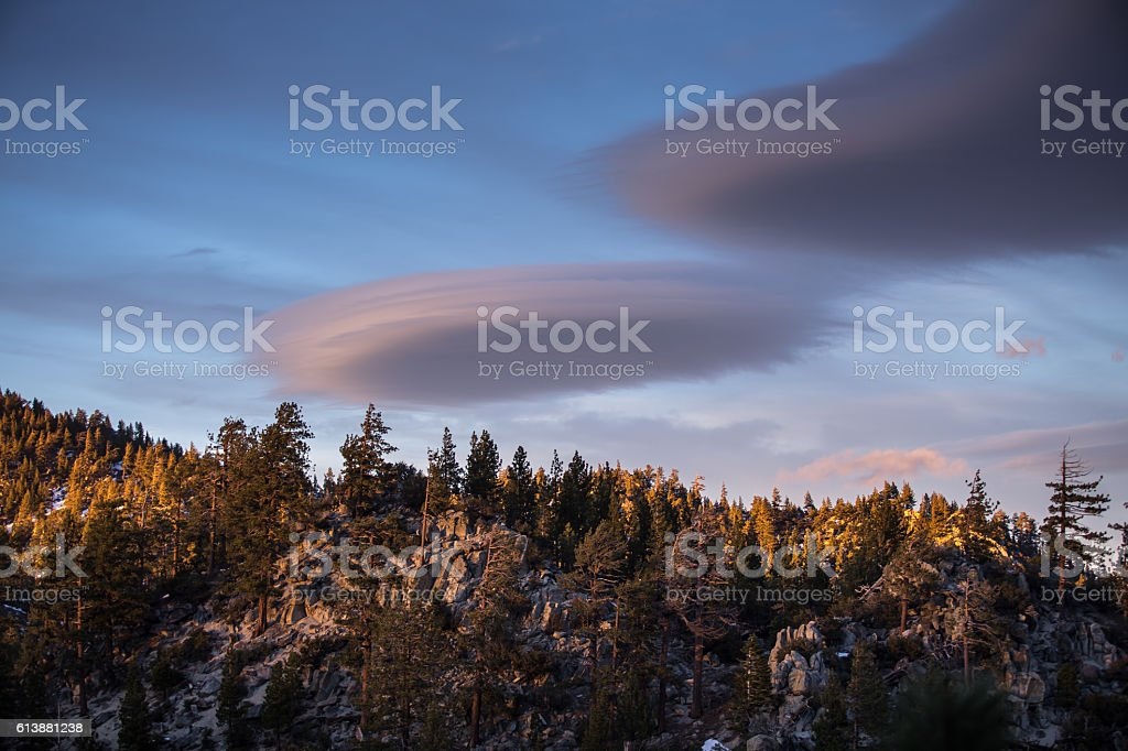 Lenticular Clouds Over Sierra Nevada Forest stock photo