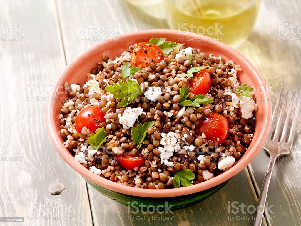 Lentil and Bulgur Salad with Feta and Fresh Spinach stock photo